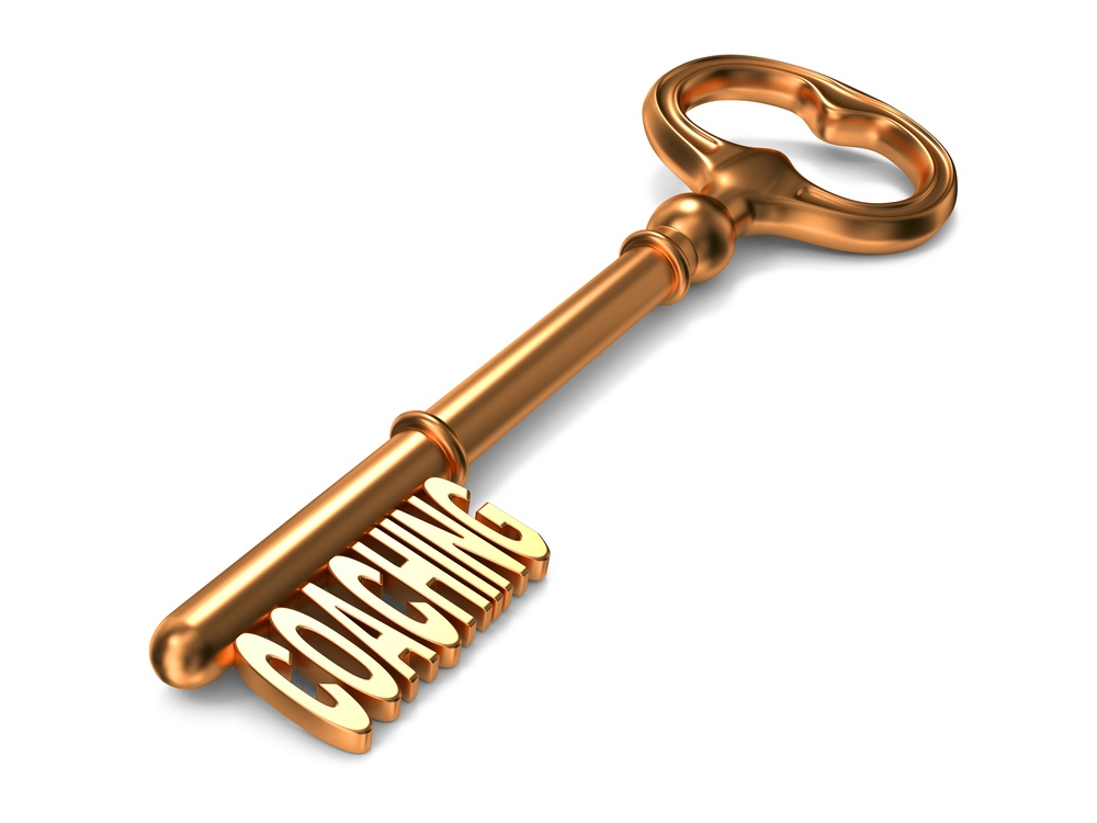Coaching - Golden Key on White Background. 3D Render. Business Concept.