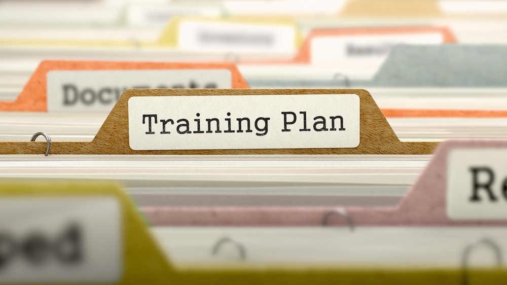 Training Plan on Business Folder in Multicolor Card Index. Closeup View. Blurred Image.-1.jpeg